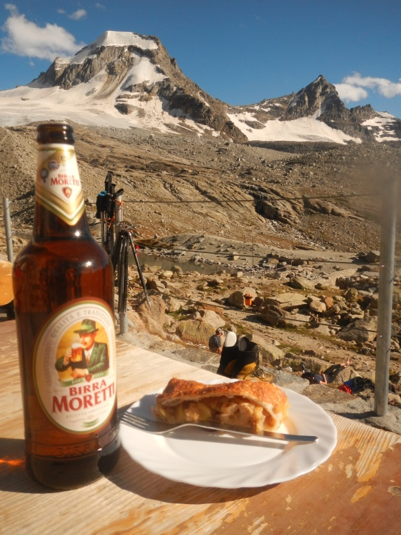 Enjoying a beer and apple turnover at Vittorio Emanuele hut.