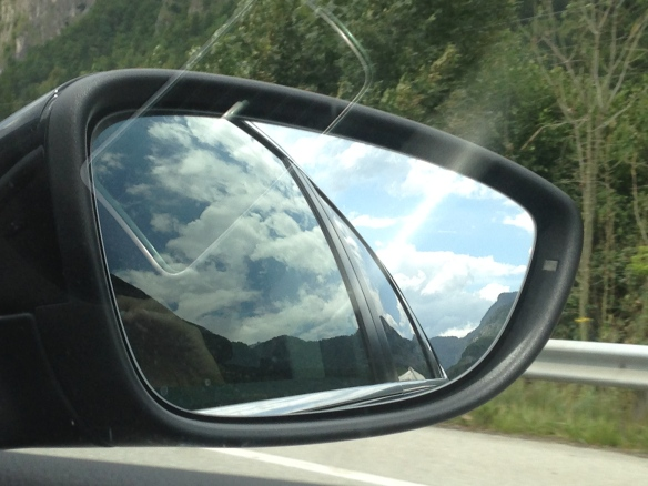 Sun and clouds of Italy in the rear view mirror