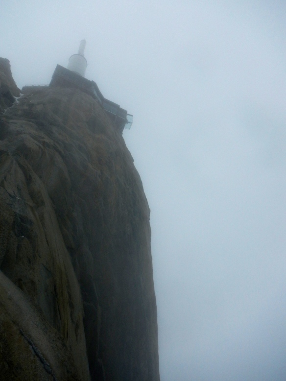 Aiguille du Midi looms above us in the cloud
