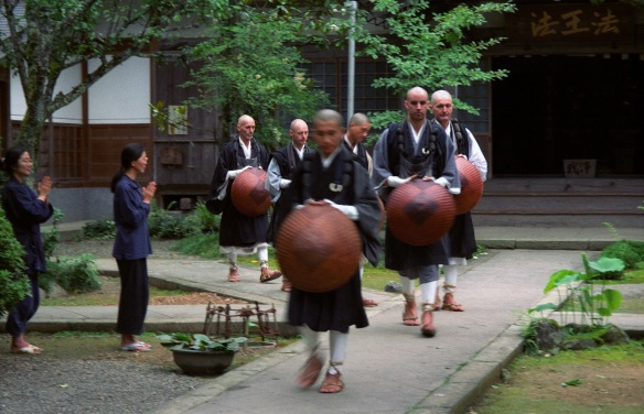Monks departing for takuhatsu