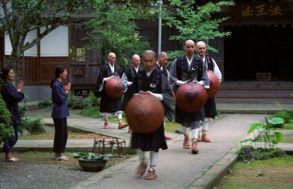 Monks departing for takuhatsu