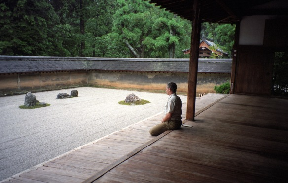 Contemplating the rock garden at Ryoanji Temple in Kyoto