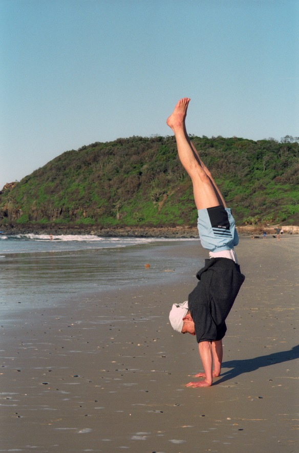 Hogen-san doing yoga on the beach at Ballina, 1995.