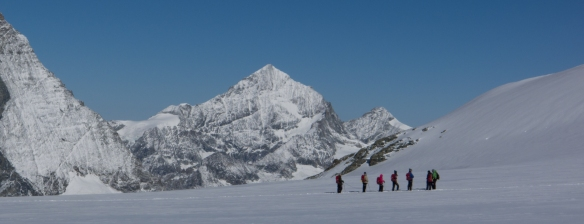 A party on the way from Klein Matterhorn to Breithorn. The lower part of the Matterhorn visible on left.